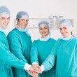 Group of medical surgeons hands together — Stock Photo