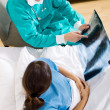 Medical surgeon visiting patient in hospital ward — Foto Stock