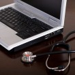 Stethoscope and laptop computer — Stock Photo