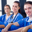 Foto Stock: Group of medical nurses resting during break
