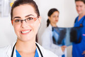 Pretty female medical doctor in hospital — Stock Photo