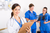 Group of healthcare workers in hospital ward — Stock Photo