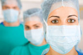 Group of medical doctors with masks — Stock Photo