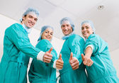 Group of medical surgeons thumbs up — Stock Photo