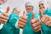 Group of medical doctors thumbs up — Stock Photo