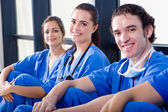 Group of medical nurses resting during break — Stock Photo