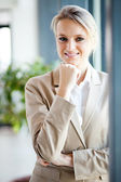 Attractive young businesswoman portrait by window — 图库照片