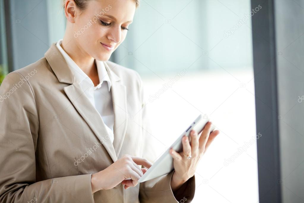 Modern young businesswoman with tablet computer — Stock Photo #12099073