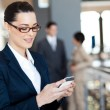 Pretty businesswoman using smart phone — Stock Photo #12288083