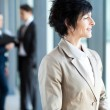 Mature businesswoman looking outside office window — Stock Photo