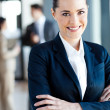 Foto Stock: Beautiful young businesswoman portrait in office
