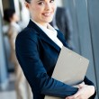 图库照片: Cute young businesswoman portrait in office