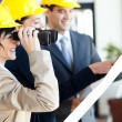 Project manager looking at construction site with binoculars — Stock Photo