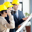 Architect looking at construction site with binoculars — Stock Photo
