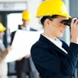 Young female architect looking at construction site — Stock Photo