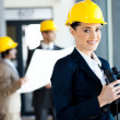 Female construction manager with binoculars — Stock Photo