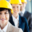 Stock Photo: Middle aged female construction business leader and team