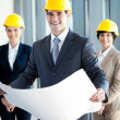 Stock Photo: Young construction manager holding blue print