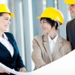 Group of happy construction businesspeople interacting — Stok fotoğraf
