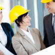 Group of architects discussing construction project — Stockfoto