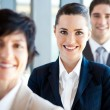 Pretty businesswoman and co-workers portrait — Stock Photo