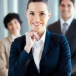 Beautiful young businesswoman and team portrait — Stock Photo