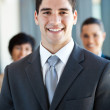Happy and handsome young businessman and co-worker — Stock Photo