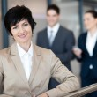 Stock Photo: Middle aged businesswoman portrait outside office
