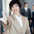 Happy middle aged businesswoman showing smart phone — Stock Photo