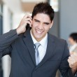 Young businessman talking on cell phone — Stock Photo #12288102