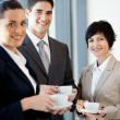Group of businesspeople having coffee — Stok fotoğraf