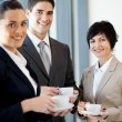 Group of businesspeople having coffee — ストック写真