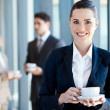 Young businesswoman having coffee break at work — Stok fotoğraf