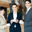 Group of colleagues having coffee break at work — Stock Photo