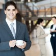 Stock Photo: Handsome businessmhaving coffee break in office