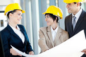 Group of happy construction businesspeople interacting — Stock Photo