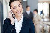 Cute young businesswoman talking on cell phone — Stock Photo