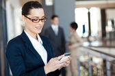 Pretty businesswoman using smart phone — Stock Photo