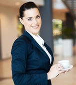 Attractive modern businesswoman having coffee — Stock Photo