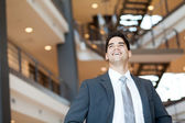 Ambitious and optimistic young businessman looking up — Stock Photo
