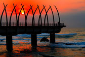 Sunrise and pier — Stock Photo