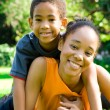 African american mother and son lying on grass outdoors — Stock Photo