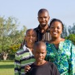 Happy african family portrait outdoors — Stock Photo #12392239