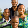 Foto Stock: Happy african american family portrait outdoors