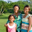 Happy african american mother and daughters portrait outdoors — Stock Photo