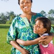 Happy african american daughter hugging mother outdoors — Stock Photo