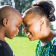 Happy african american mother and son outdoors — Stock Photo