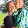 Happy african american mother hugging son outdoors — Stock Photo