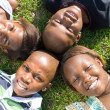 Stock Photo: Group of african american children lying on grass