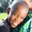 Cute african american boy hugging mother — Stock Photo